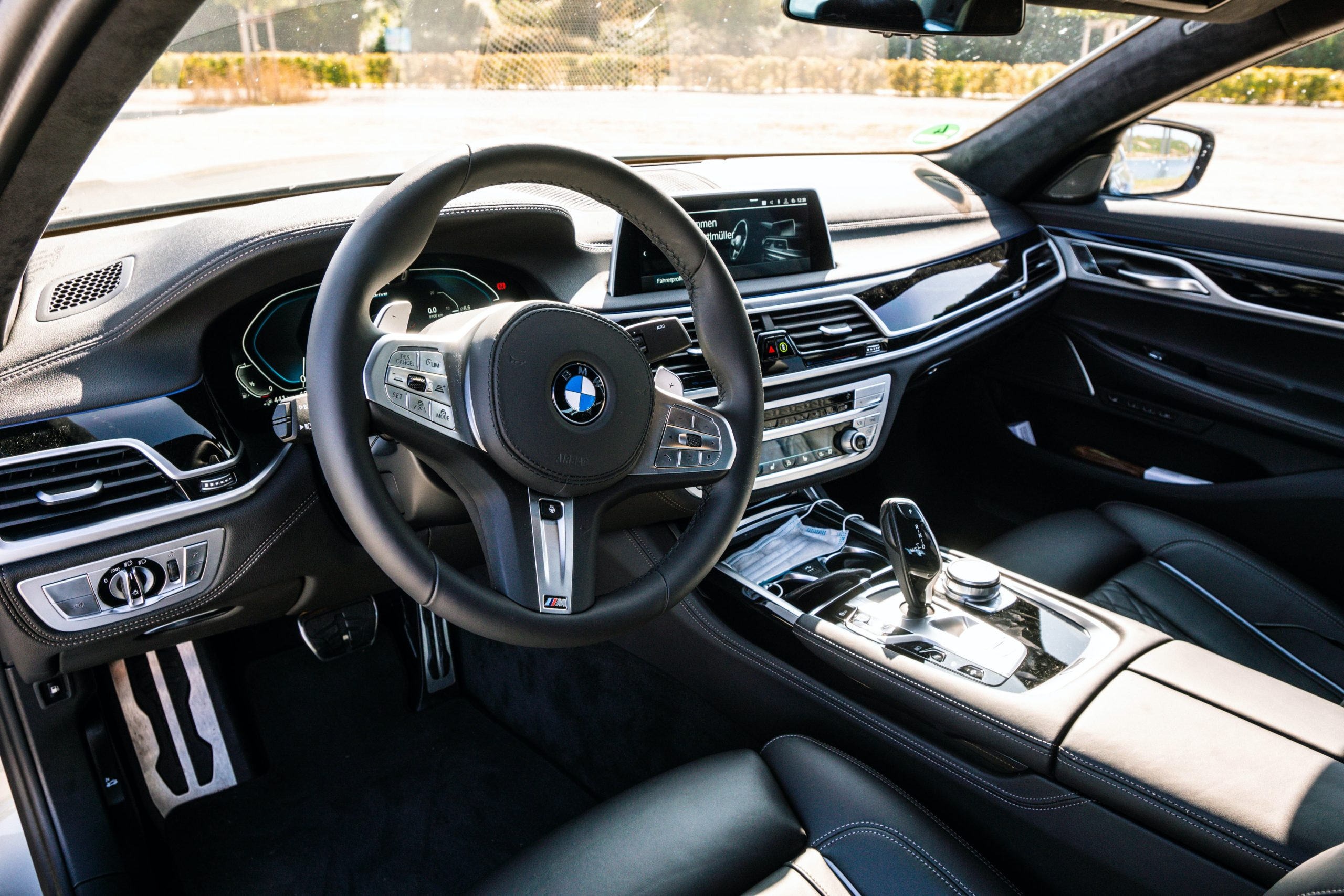 A BMWs driving wheel and dashboard